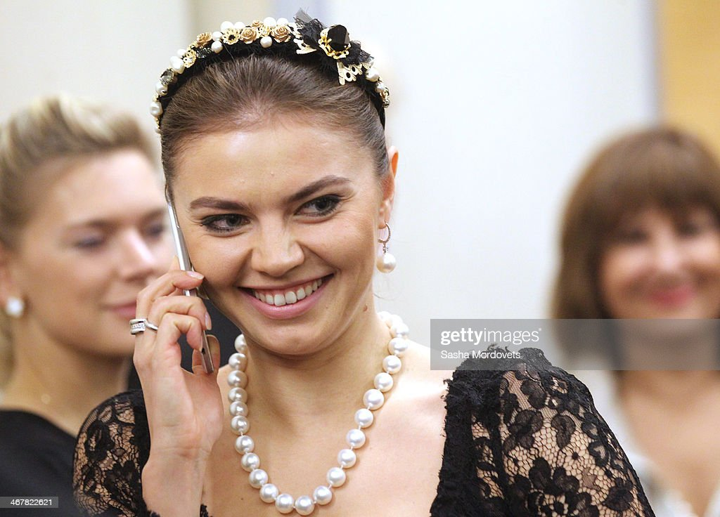 Russian retired rhytmic gymnast and politican <a gi-track='captionPersonalityLinkClicked' href=/galleries/search?phrase=Alina+Kabaeva&family=editorial&specificpeople=633246 ng-click='$event.stopPropagation()'>Alina Kabaeva</a> attends a reception at the Bocharov Ruchey state residence ion February 8, 2014 in Sochi, Russia. Putin called Russian athletes, musicians and artists for the reception to mark the begining of the 2014 Winter Olympics.