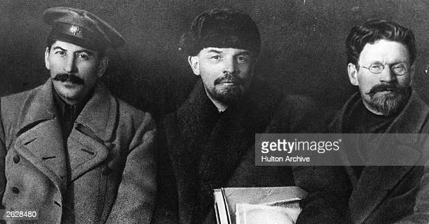 Russian revolutionaries and leaders Joseph Stalin Vladimir Ilyich Lenin and Mikhail Ivanovich Kalinin at the Congress of the Russian Communist Party