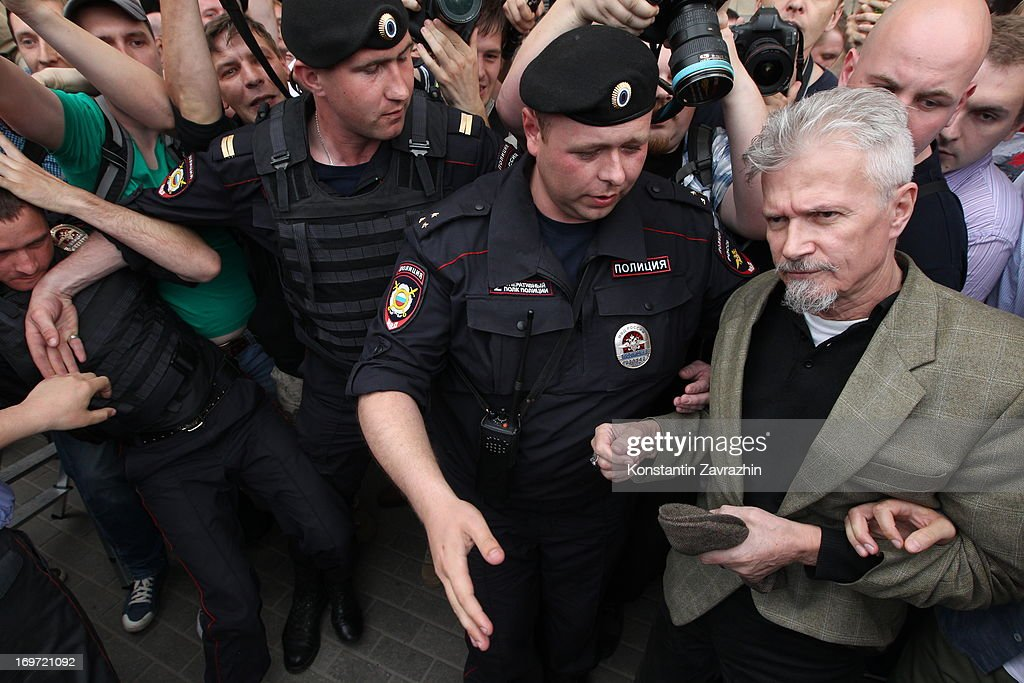 Russian riot police detain writer, opposition leader and initiator of the Strategy-31 campaign <a gi-track='captionPersonalityLinkClicked' href=/galleries/search?phrase=Eduard+Limonov&family=editorial&specificpeople=756882 ng-click='$event.stopPropagation()'>Eduard Limonov</a> (C) during an unsanctioned Strategy-31 civic protest in Triumfalnaya Square on May 31, 2013 in central Moscow, Russia. The Strategy-31 campaign, which organises protests on the 31st day of every month with 31 days, supports the right to peacefull assembly guaranteed in the Russian Constitution by Article 31. Russian police detained a number of activists during the protest.