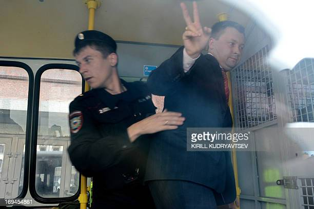 A Russian riot policeman detains gay and LGBT rights activist Nikolai Alexeyev during unauthorized gay rights activists rally in cental Moscow on May...