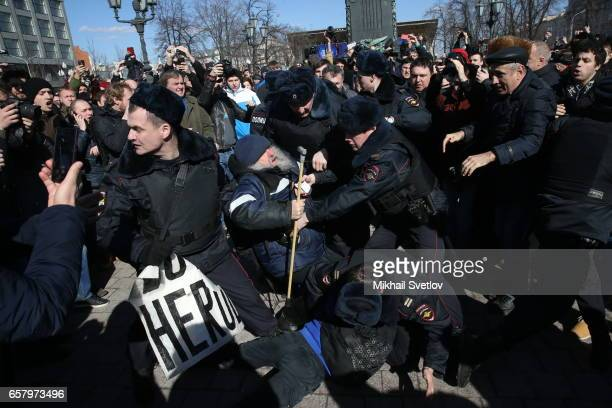Russian riot policemen detain an opposition activist during a protest rally at Pushkinskaya Square on March 26 2017 in Moscow Russia Russia's leading...