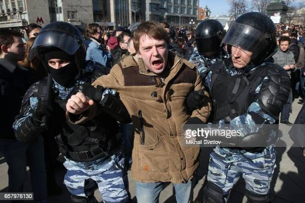 Russian riot policemen detain an opposition activist during a protest rally at Pushkinskaya Square on March 26 2017 in Moscow Russia Russia Russia's...