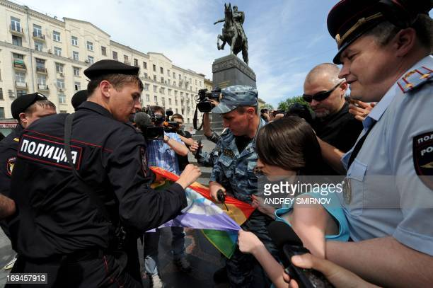 Russian riot policemen detain gay and LGBT rights activists during unauthorized gay rights activists rally in cental Moscow on May 25 2013 AFP...