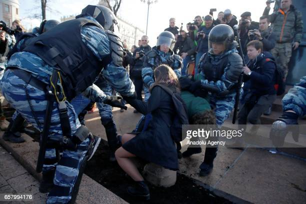 Russian riot policemen detain protesters during an opposition rally on March 26 2017 in Moscow
