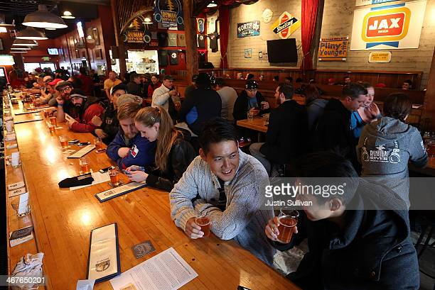 Russian River Brewing Company customers drink the newly released Pliny the Younger triple IPA beer on February 7 2014 in Santa Rosa California...