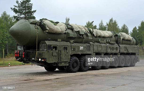 A Russian RS24 Yars thermonuclear intercontinental ballistic missile launcher rolls at a strategic missile forces base near the town of Teykovo some...