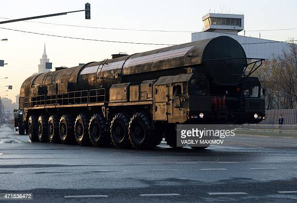 A Russian RS24 Yars thermonuclear intercontinental ballistic missile launcher is driven during Victory Day military parade night training on April 29...