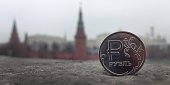 A Russian ruble coin is pictured in front of the Kremlin in in central Moscow on November 6 2014 After having recently spent billions of dollars per...