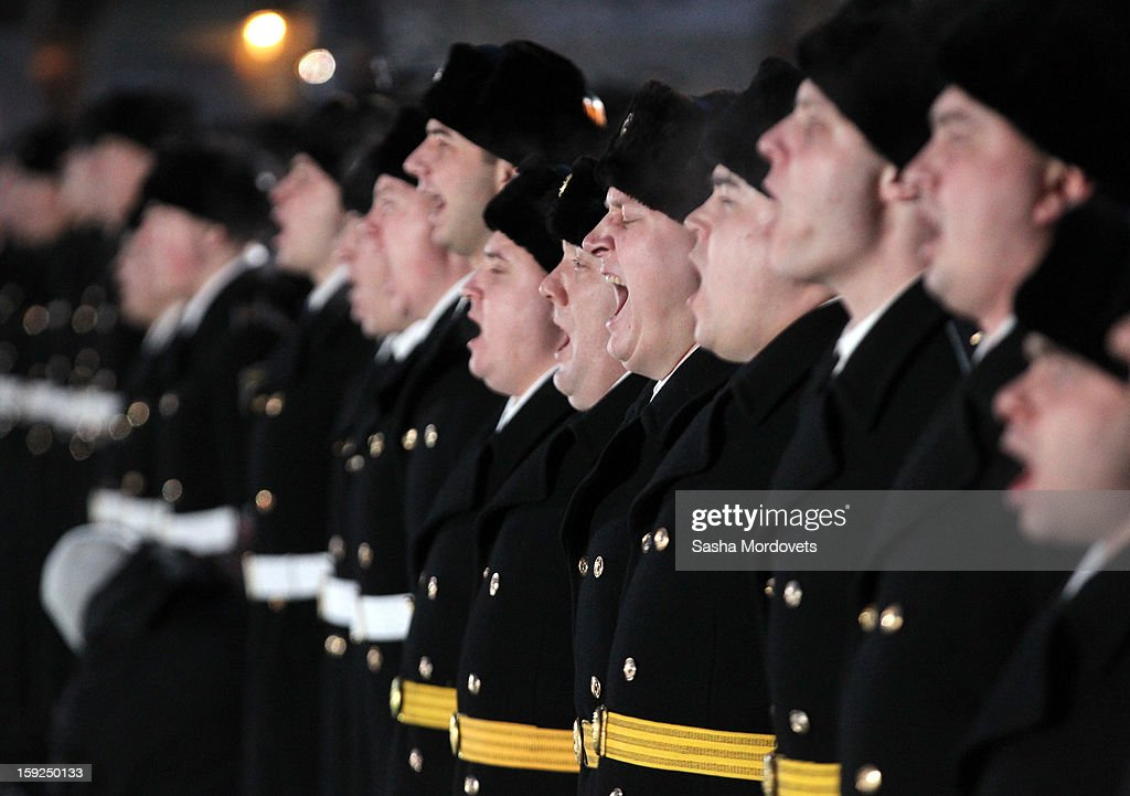Russian sailors greets President Vladimir Putin (unseen) during his visit during his visit to the heavy nuclear-powered missile cruiser Pyotr Veliky at the Russian Northern Fleet's base January 10, 2013 in Severomorsk, Russia. Putin awarded the crew of the Pyotr Veliky the Nakhimov order.