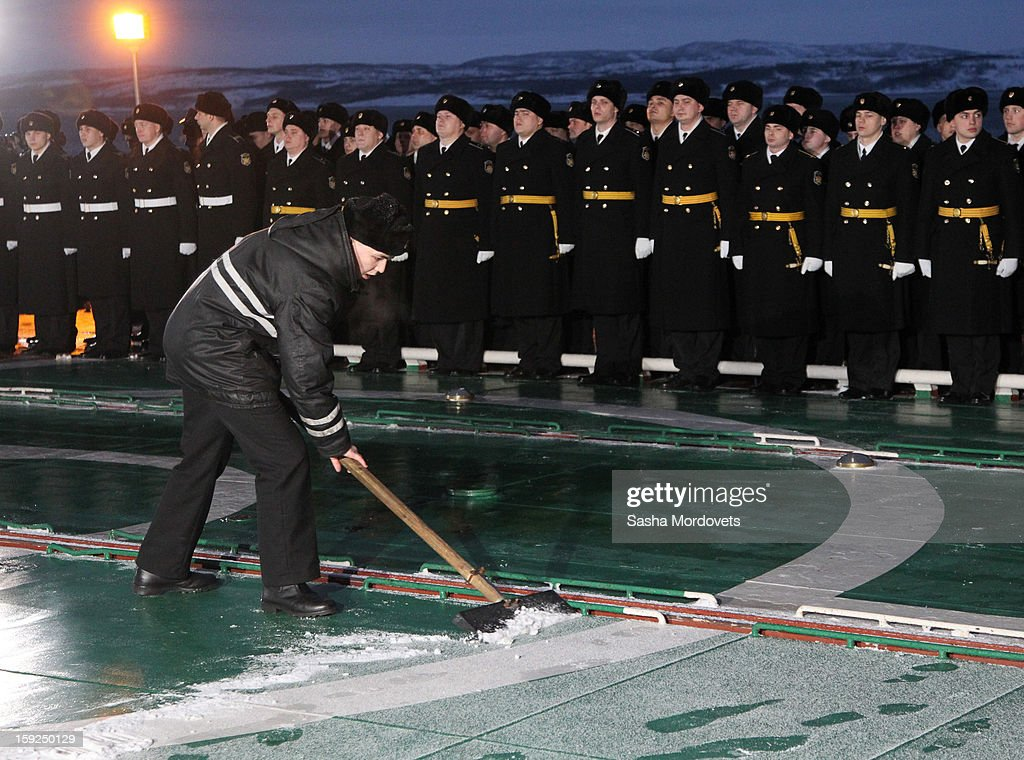 Russian sailors greets President Vladimir Putin (unseen) during his visit to the heavy nuclear-powered missile cruiser Pyotr Veliky at the Russian Northern Fleet's base January 10, 2013 in Severomorsk, Russia. Putin awarded the crew of the Pyotr Veliky the Nakhimov order.