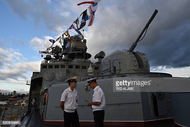 Russian sailors stand guard at the bow of the Russian antisubmarine ship Admiral Tributs at South Pier in Manila on January 4 2017 The Russian Navy...