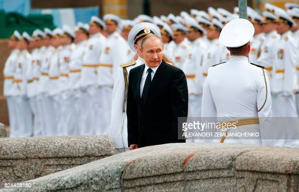 TOPSHOT Russian sailors stand in attention as Russian President Vladimir Putin leaves after attending the military parade during the Navy Day...