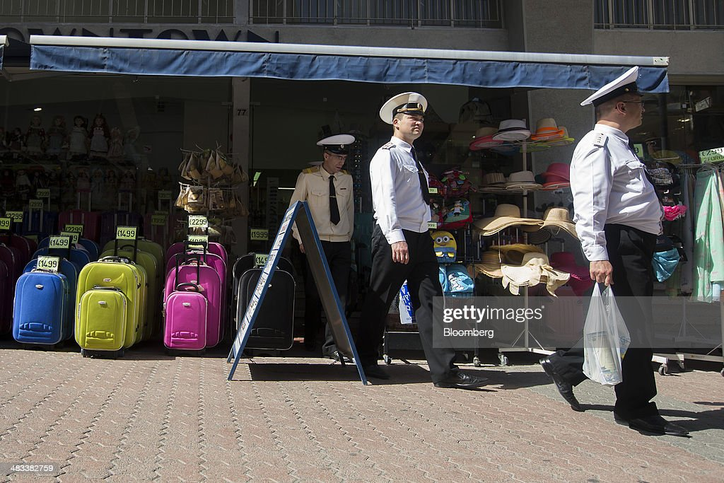 Russian sailors walk out after shopping for souvenirs in a tourist store in Limassol, Cyprus, on Tuesday, April 8, 2014. Cyprus is the biggest foreign investor in Russia with $69 billion dollars accumulated through the end of last year, while the island is the second-biggest destination for Russian investment at $33 billion, according to the Moscow-based Federal Statistics Service. Photographer: Andrew Caballero-Reynolds/Bloomberg via Getty Images