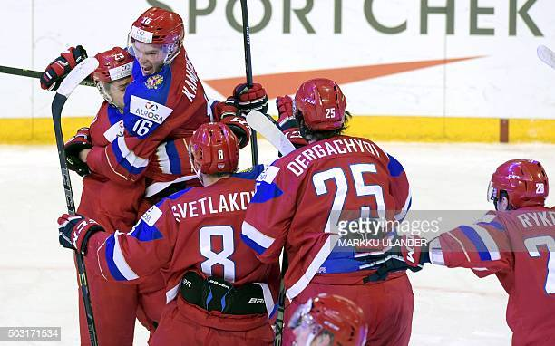 Russian scorer Vladislav Kamenevia celebrates with his teammates during the 2016 IIHF World Junior Ice Hockey Championship quarterfinal match between...
