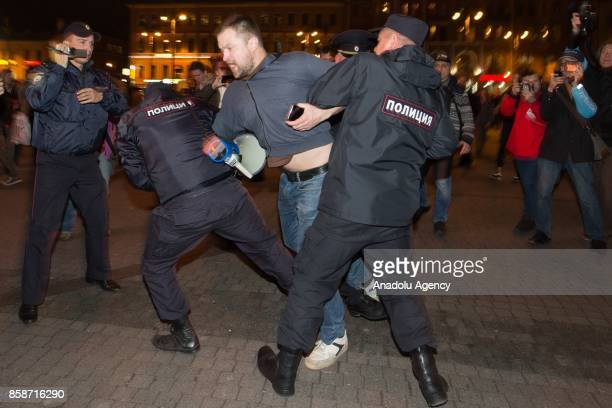 Russian security forces take a demonstrator into custody during an unauthorized antiKremlin rally called by opposition leader Alexei Navalny who is...
