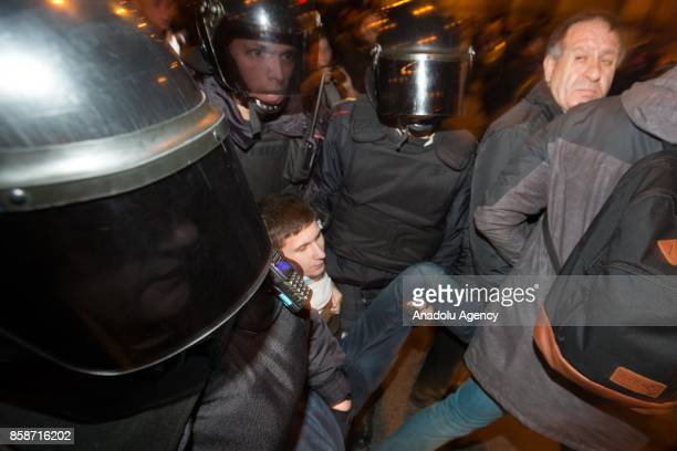 Russian security forces take demonstrators into custody by force during an unauthorized antiKremlin rally called by opposition leader Alexei Navalny...