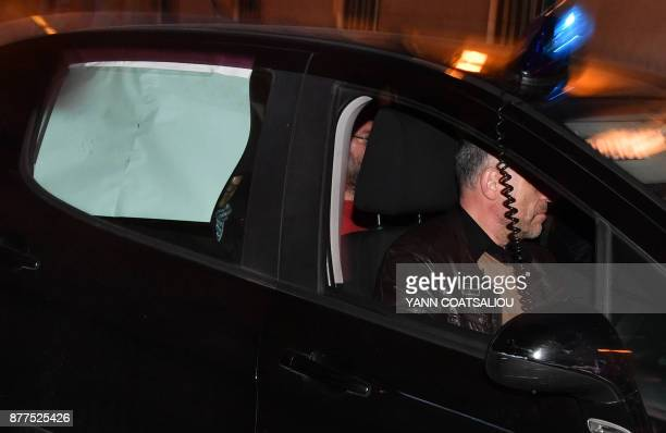Russian Senator Suleiman Kerimov is escorted by French police in a car to the Nice Courthouse on November 22 where he faced a second day of...