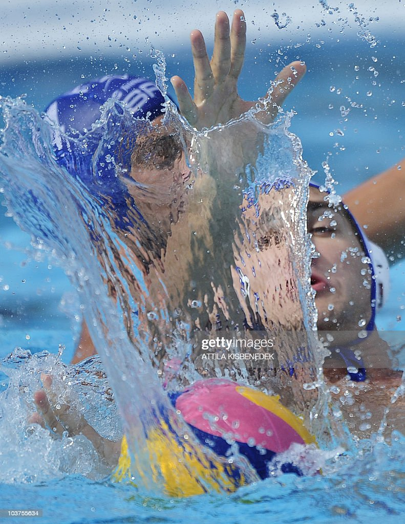 Russian Sergey Lisunov figths for the ball with Serbian Vanja Udovicic in the Mladost venue swimming pool of Zagreb on September 1 2010 during their...