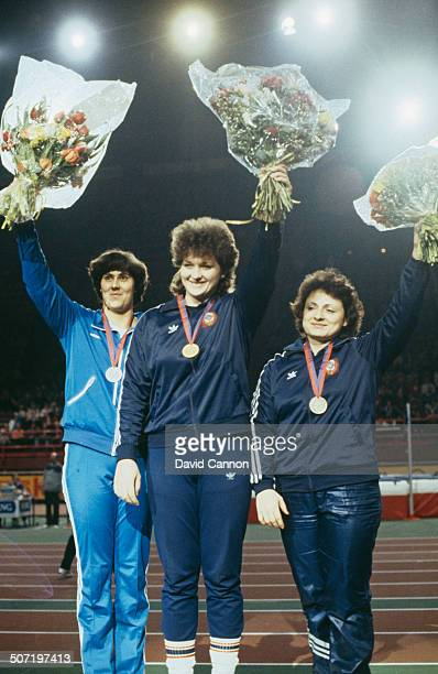 Russian shot putter Natalya Lisovskaya receives the gold medal at the IAAF World Indoor Games Paris France January 1985 On the podium with Lisovskaya...