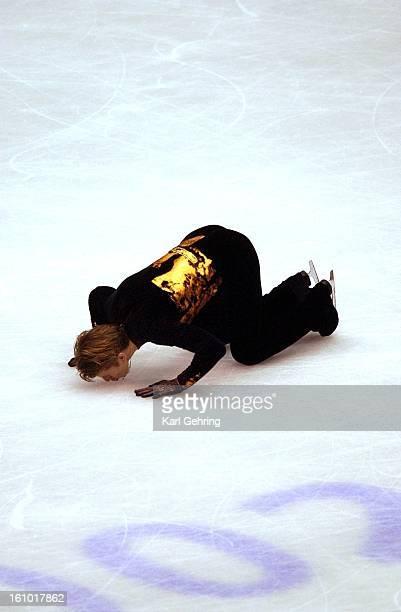 OLYMPICS Russian skater Alexei Yagudin kisses the ice after finninshing his free skate routine Thursday night Feb 14 Yagudin won The gold Denver Post...