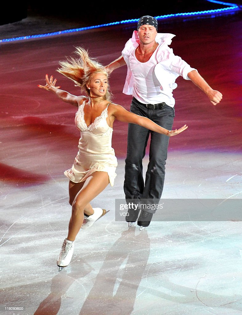 Russian skaters <a gi-track='captionPersonalityLinkClicked' href=/galleries/search?phrase=Tatiana+Navka&family=editorial&specificpeople=215488 ng-click='$event.stopPropagation()'>Tatiana Navka</a> and <a gi-track='captionPersonalityLinkClicked' href=/galleries/search?phrase=Roman+Kostomarov&family=editorial&specificpeople=209286 ng-click='$event.stopPropagation()'>Roman Kostomarov</a> perform at Artistry On Ice at Capital Indoor Stadium on July 16, 2011 in Beijing, China.
