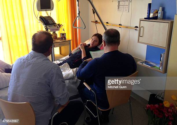 Russian skier cross Maria Komissarova receives a visit from the Russian Freestyle federation during her rehabilitation on March 19 2014 in Munich...