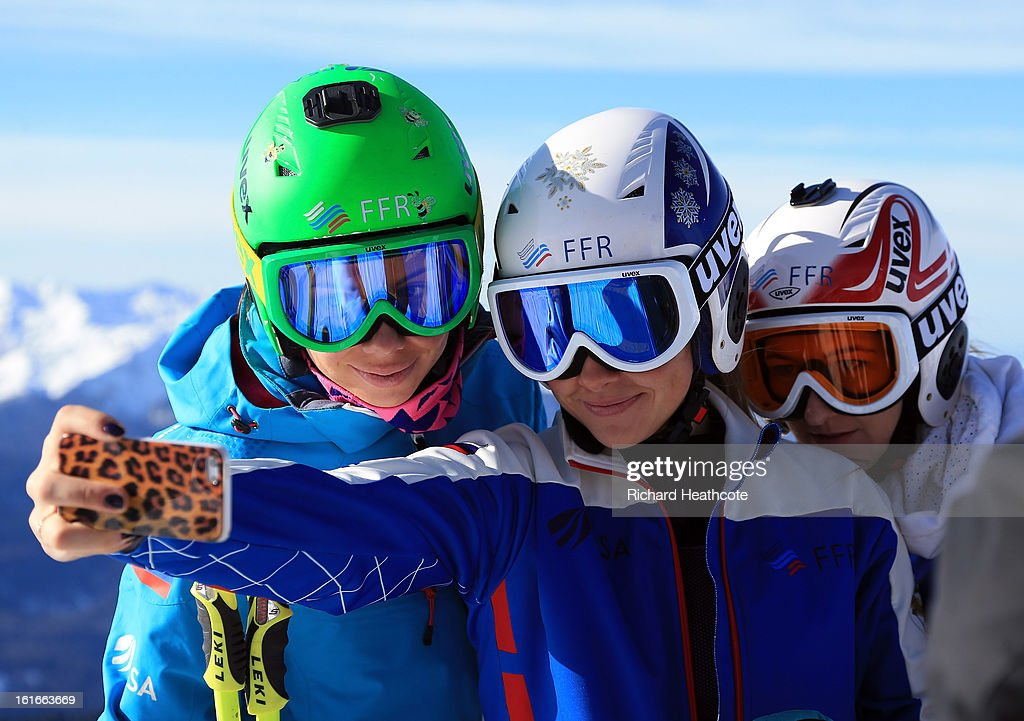 Russian skiers take a picture of themseleves on the peak at the Rosa Khutor Alpine Ski Resort in Krasnaya Polyana on February 14, 2013 in Sochi, Russia. Sochi is preparing for the 2014 Winter Olympics with test events across the venues.
