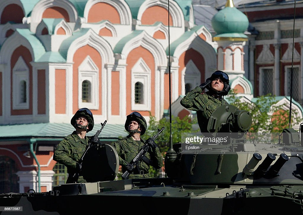 A Russian soldier salutes while driving during the nation's Victory Day parade in commemoration of the end of WWII held at the Red Square on May 9, 2009 in Moscow, Russia. The ceremony commemorates Victory Day of May 9, 1945 on which the World War II Allies' achieved victory over and unconditional surrender of Nazi Germany's armed forces.