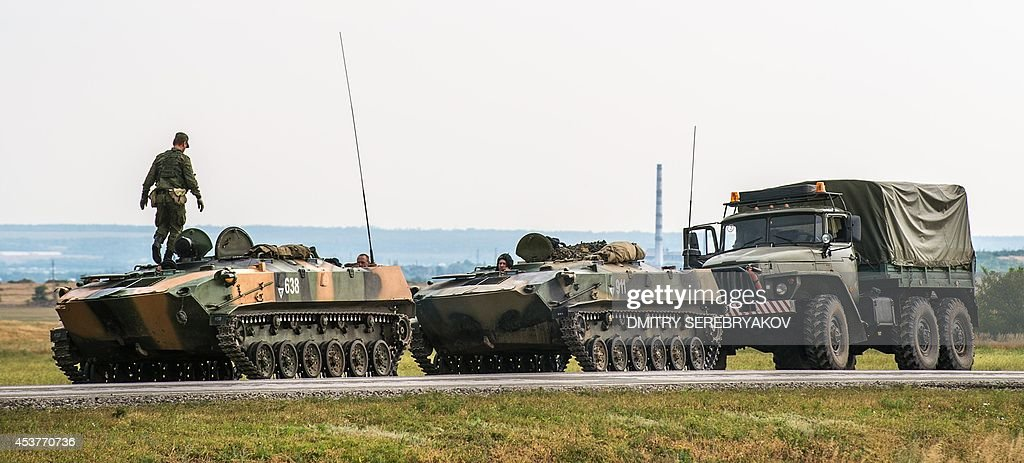 A russian soldier walks on the top of a tank some 10 km outside the southernRussian city of Donetsk on August 18 2014 Russian Foreign Minister Sergei...