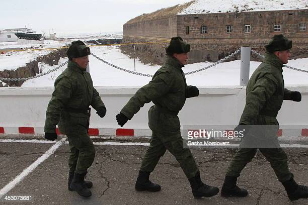 Russian soldiers march by the 102nd military base December 2 2013 in Gyumri Armenia Russian President Vladimir Putin is in a oneday state visit to...