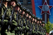 Russian soldiers march during a Victory Day parade at the Red Square in Moscow on May 9 2014 Thousands of Russian troops marched today in Red Square...