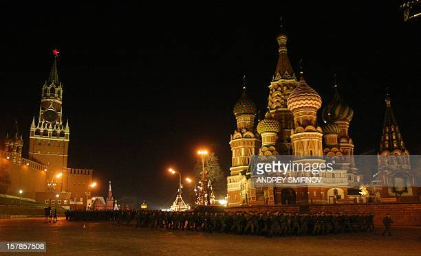 Russian soldiers march past St Basil's cathedral on Red Square during a Victory Day military parade night rehearsal in Moscow on April 27 2010 Russia...