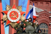 Russian soldiers ride atop their armoured personnel carrier at the Red Square in Moscow on May 9 during a Victory Day parade Thousands of Russian...