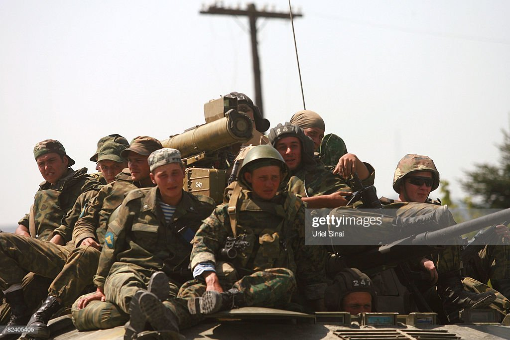 Russian soldiers sit on top of an Armoured Personnel Carrier at a Russian army position on August 18 2008 just outside the town of Gori Georgia...