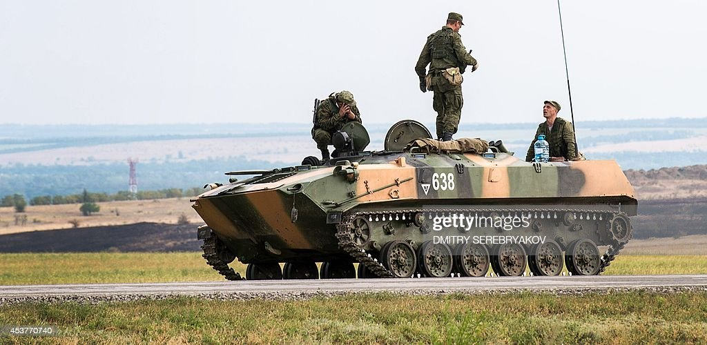 Russian soldiers talks to each other on the top of a tank some 10 km outside the southernRussian city of Donetsk on August 18 2014 Russian Foreign...
