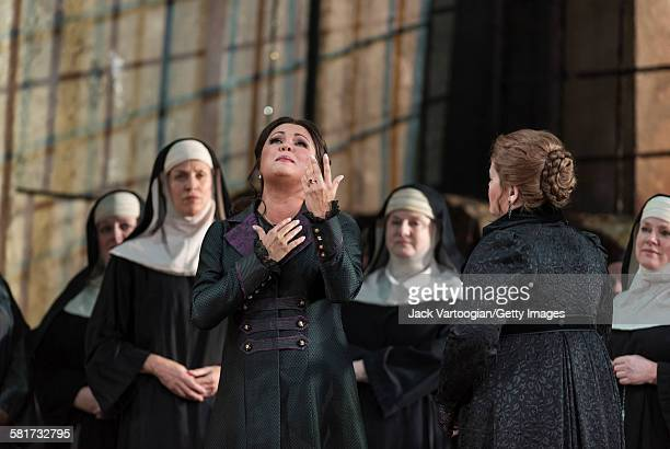 Russian soprano Anna Netrebko performs and the chorus at the final dress rehearsal prior to the season premiere of the Metropolitan Opera/Sir David...