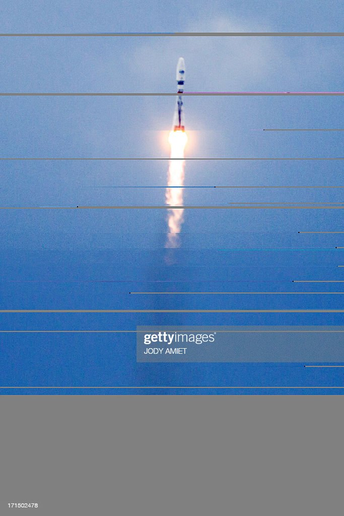 A Russian Soyouz rocket, carrying four O3b Satellite Constellation, is launched from Kourou space base in the French overseas department of Guiana on June 25, 2013.
