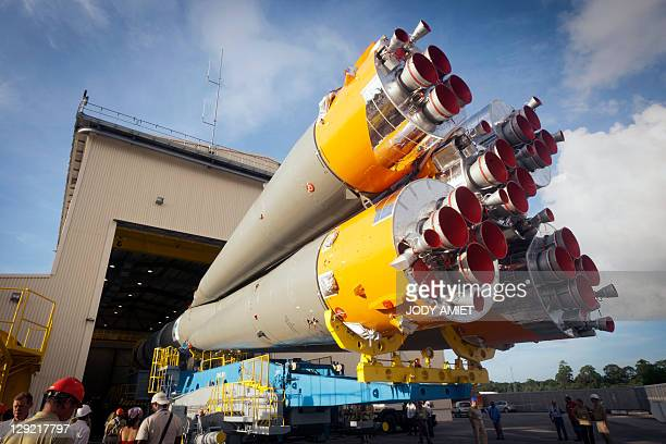 A Russian Soyuz rocket is transfered to Arianespace's launch pad on October 14 2011 at Europe's Spaceport launch site in Kourou French Guiana...
