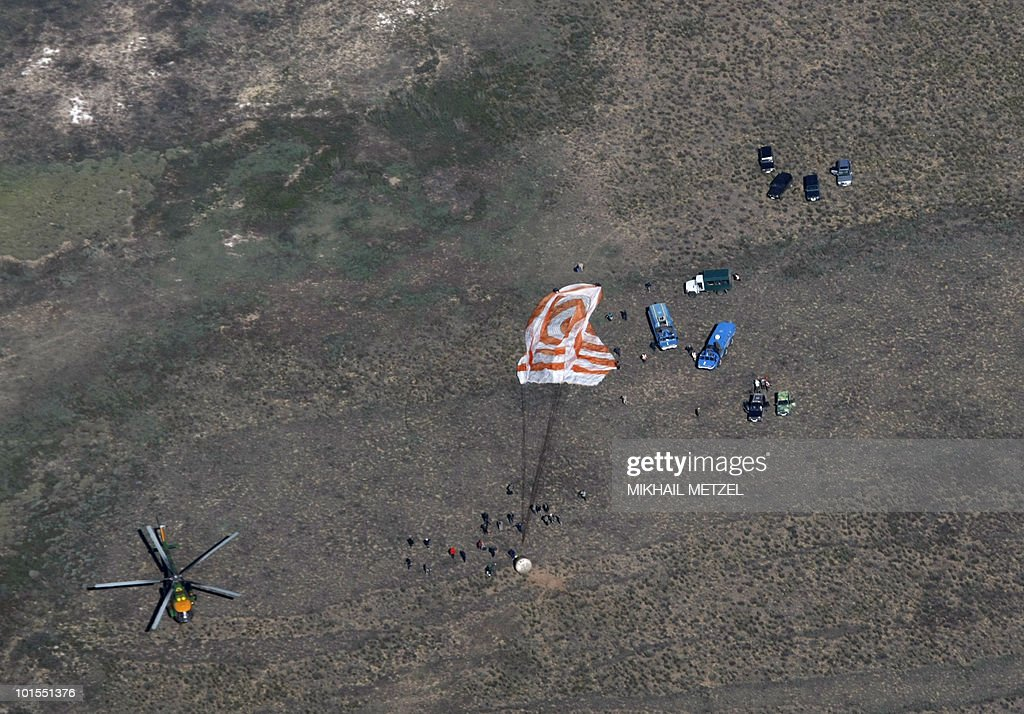 A Russian Soyuz TMA-17 space capsule lands about 150 km (80 miles) south-east of the Kazakh town of Dzhezkazgan on June 2, 2010. The Soyuz capsule, which carried the three astronauts safely returned to Earth after a half-year stint on the international space station, with a landing in the Kazakh steppe.
