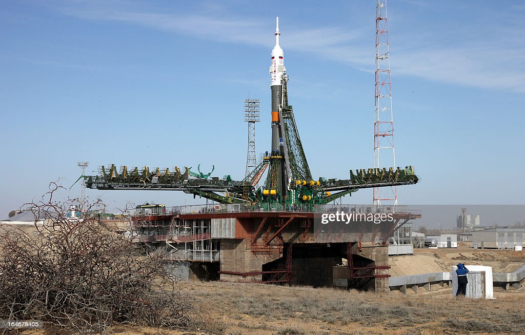 Russian Soyuz-FG rocket with Soyuz TMA-08M spacecraft aboard is mounted at a launch pad at the Russian leased Kazakh Baikonur cosmodrome, on March 26, 2013. Russian cosmonauts Pavel Vinogradov, Alexander Misurkin and US astronaut Christopher Cassidy are scheduled to blast off for the International Space Station (ISS) from the Baikonur cosmodrome on March 29.