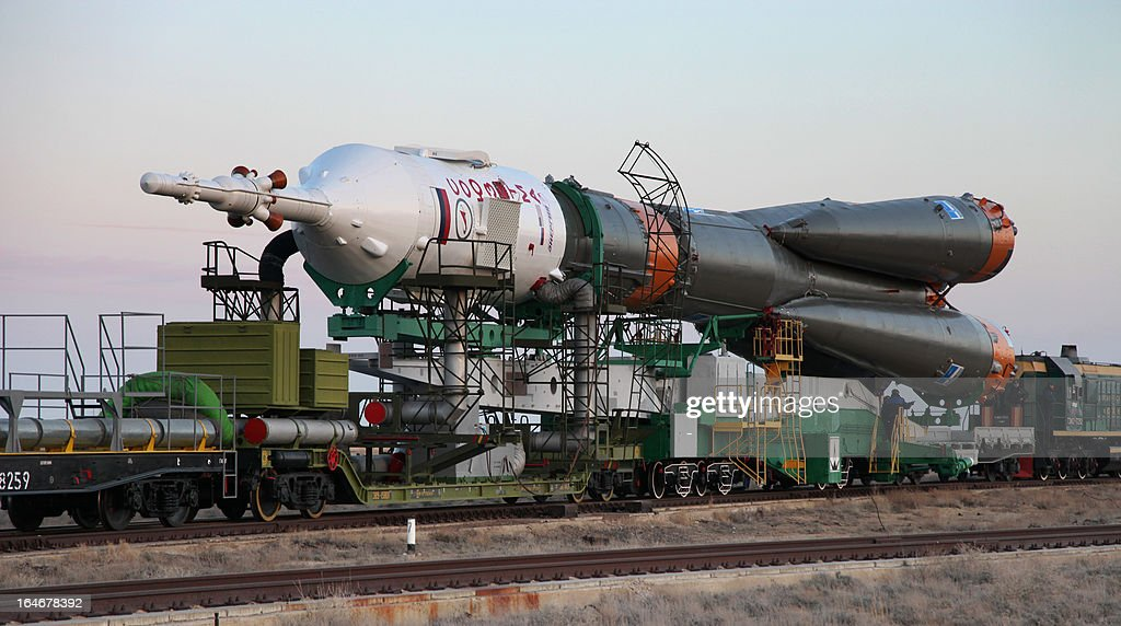 Russian Soyuz-FG rocket with Soyuz TMA-08M spacecraft aboard is transported to a launch pad at the Russian leased Kazakh Baikonur cosmodrome, on March 26, 2013. Russian cosmonauts Pavel Vinogradov, Alexander Misurkin and US astronaut Christopher Cassidy are scheduled to blast off for the International Space Station (ISS) from the Baikonur cosmodrome on March 29.