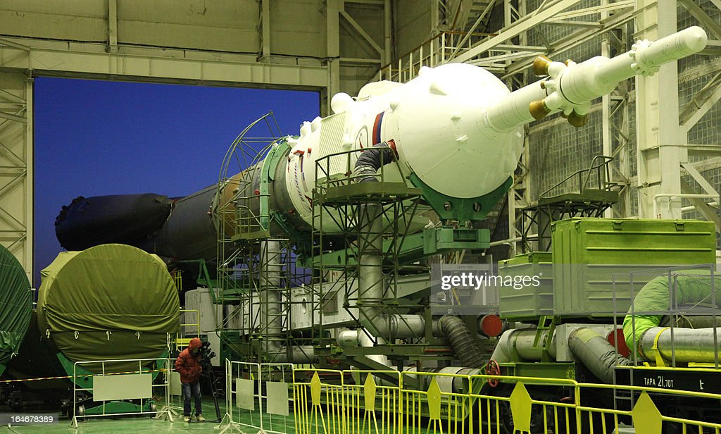 Russian Soyuz-FG rocket with Soyuz TMA-08M spacecraft aboard leaves an assembly facility at the Russian leased Kazakh Baikonur cosmodrome, on March 26, 2013, on its way to a launch pad. Russian cosmonauts Pavel Vinogradov, Alexander Misurkin and US astronaut Christopher Cassidy are scheduled to blast off for the International Space Station (ISS) from the Baikonur cosmodrome on March 29.