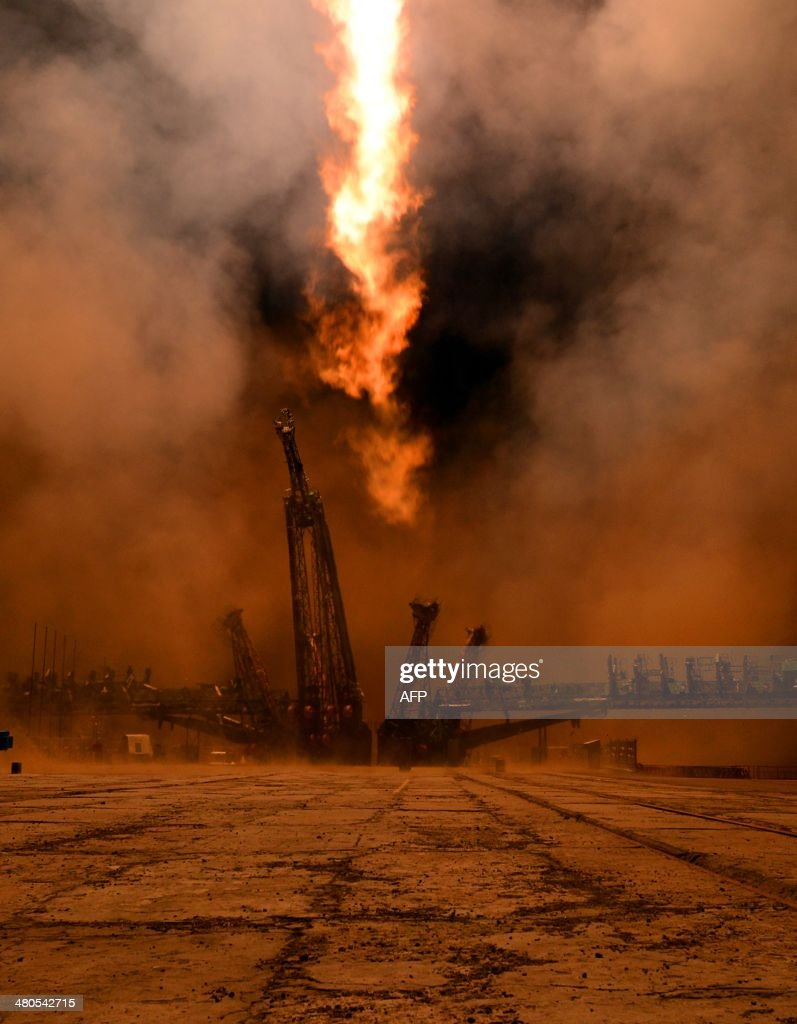 Russian Soyuz-FG rocket with the Soyuz TMA-12M spacecraft and a crew of US astronaut Steven Swanson, Russian cosmonauts Alexander Skvortsov and Oleg Artemyev aboard, blasts off from a launch pad at the Russian-leased Baikonur cosmodrome in Kazakhstan, early on March 26, 2014. A crew of two Russian cosmonauts and an American astronaut blasted off today from Kazakhstan on a Russian Soyuz rocket for the International Space Station, with US-Russia space cooperation pressing on despite the diplomatic standoff over Ukraine.