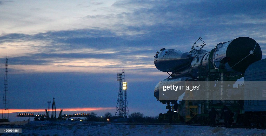 A Russian SoyuzU booster carrying an unmanned cargo spacecraft Progress M22M is transported to a launch pad at the Russian leased Kazakhstan's...