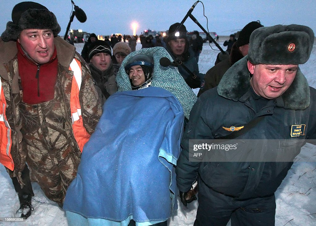 Russian space agency rescuers carry a crew member of the International Space Station (ISS), Japanese astronaut <a gi-track='captionPersonalityLinkClicked' href=/galleries/search?phrase=Akihiko+Hoshide&family=editorial&specificpeople=5329772 ng-click='$event.stopPropagation()'>Akihiko Hoshide</a>, shortly after his landing in Soyuz capsule near the town of Arkalyk in northern Kazakhstan, early on November 19, 2012. Russian cosmonaut Yury Malenchenko and two astronauts, Sunita Williams of the US and <a gi-track='captionPersonalityLinkClicked' href=/galleries/search?phrase=Akihiko+Hoshide&family=editorial&specificpeople=5329772 ng-click='$event.stopPropagation()'>Akihiko Hoshide</a> of Japan, touched down early today on the steppes of Kazakhstan in a Russian Soyuz capsule after spending over four months aboard the International Space Station (ISS).