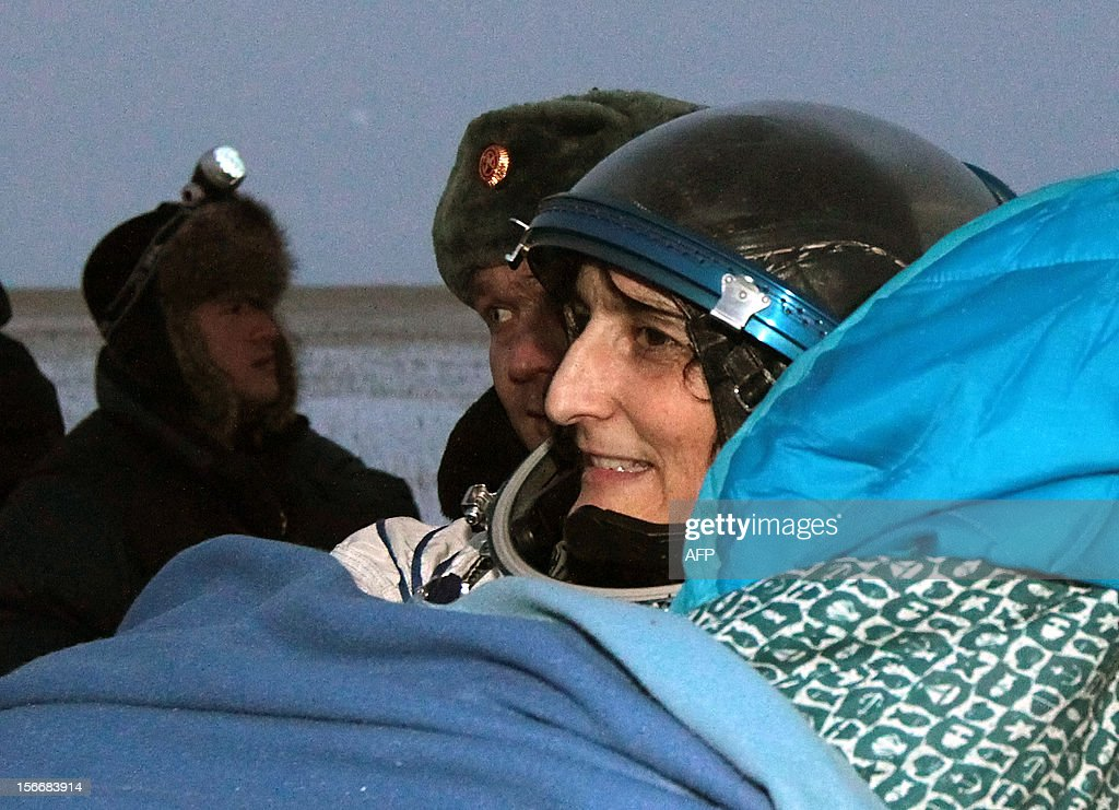 Russian space agency rescuers carry a crew member of the International Space Station (ISS), US astronaut Sunita Williams, shortly after her landing in Soyuz capsule near the town of Arkalyk in northern Kazakhstan, early on November 19, 2012. Russian cosmonaut Yury Malenchenko and two astronauts, Sunita Williams of the US and Akihiko Hoshide of Japan, touched down early today on the steppes of Kazakhstan in a Russian Soyuz capsule after spending over four months aboard the International Space Station (ISS).