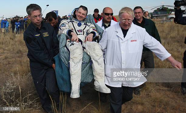 Russian space agency rescuers carry Russian cosmonaut Alexander Samokutyayev after his landing aboard the Soyuz TMA21 space capsule about 150 km...