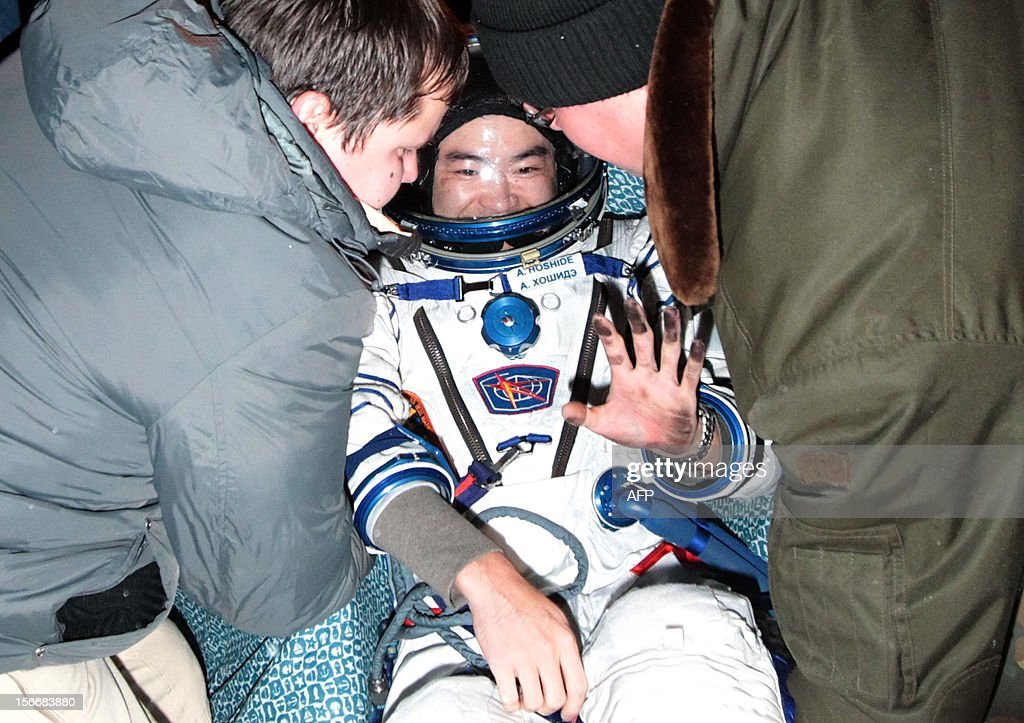 Russian space agency rescuers help a crew member of the International Space Station (ISS), Japanese astronaut <a gi-track='captionPersonalityLinkClicked' href=/galleries/search?phrase=Akihiko+Hoshide&family=editorial&specificpeople=5329772 ng-click='$event.stopPropagation()'>Akihiko Hoshide</a>, shortly after his landing in Soyuz capsule near the town of Arkalyk in northern Kazakhstan, early on November 19, 2012. Russian cosmonaut Yury Malenchenko and two astronauts, Sunita Williams of the US and <a gi-track='captionPersonalityLinkClicked' href=/galleries/search?phrase=Akihiko+Hoshide&family=editorial&specificpeople=5329772 ng-click='$event.stopPropagation()'>Akihiko Hoshide</a> of Japan, touched down early today on the steppes of Kazakhstan in a Russian Soyuz capsule after spending over four months aboard the International Space Station (ISS).