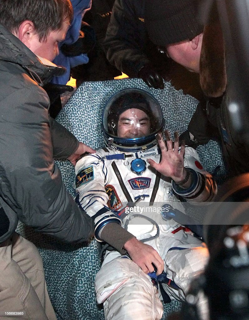 Russian space agency rescuers help a crew member of the International Space Station (ISS), Japanese astronaut <a gi-track='captionPersonalityLinkClicked' href=/galleries/search?phrase=Akihiko+Hoshide&family=editorial&specificpeople=5329772 ng-click='$event.stopPropagation()'>Akihiko Hoshide</a>, shortly after his landing in Soyuz capsule near the town of Arkalyk in northern Kazakhstan, early on November 19, 2012. Russian cosmonaut Yury Malenchenko and two astronauts, Sunita Williams of the US and <a gi-track='captionPersonalityLinkClicked' href=/galleries/search?phrase=Akihiko+Hoshide&family=editorial&specificpeople=5329772 ng-click='$event.stopPropagation()'>Akihiko Hoshide</a> of Japan, touched down early today on the steppes of Kazakhstan in a Russian Soyuz capsule after spending over four months aboard the International Space Station (ISS). AFP PHOTO / POOL /MAXIM SHIPENKOV