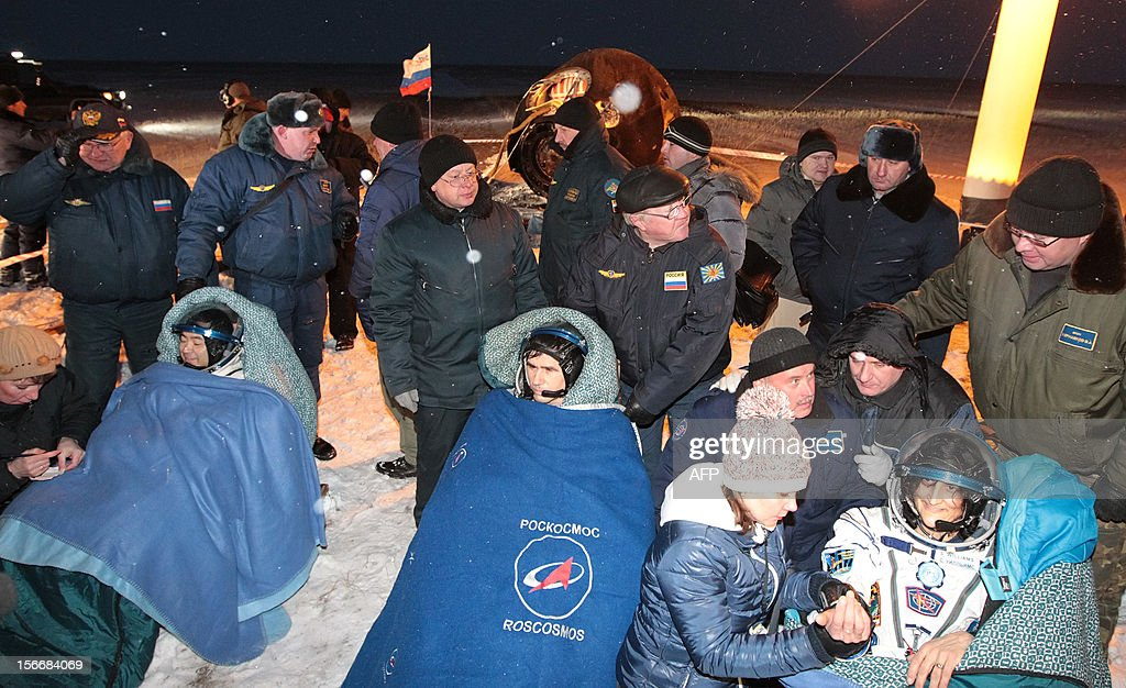 Russian space agency rescuers help the crew members of the International Space Station (ISS), Russian cosmonaut Yury Malenchenko (C) and two astronauts, Sunita Williams of the US (R) and Akihiko Hoshide of Japan (L) , shortly after their landing in Soyuz capsule near the town of Arkalyk in northern Kazakhstan, early on November 19, 2012. Yury Malenchenko, Sunita Williams and Akihiko Hoshide of Japan, touched down early today on the steppes of Kazakhstan in a Russian Soyuz capsule after spending over four months aboard the International Space Station (ISS).